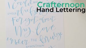 An image of some hand lettering made by Rosie & Ramona. It says 'Under the bridge downtown, forgot about my love, under the bridge downtown' which are lyrics from 'Under the Bridge' by Red Hot Chilli Peppers.