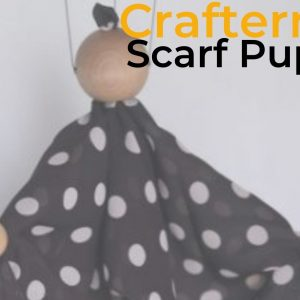 An image of a marionette puppet made from a spotty material. It has wires coming from the head and arms of it.